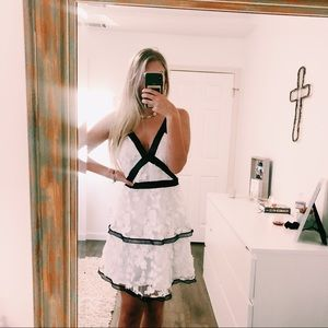 ASOS Dresses - ASOS White Lace Ruffle Dress Size 6 Black Trim